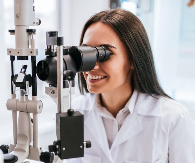 Women doing eye health tips by an eye exam