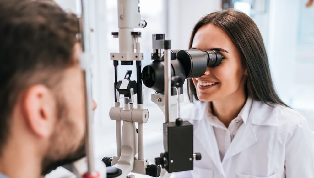 woman eye doctor checking a patient with vision insurance