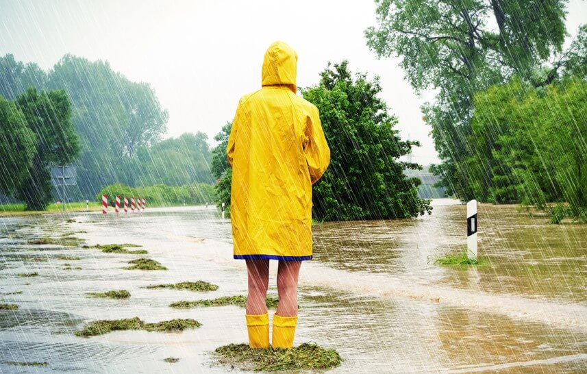 girl with yellow raincoat watching a flood in the rain do i need flood insurance