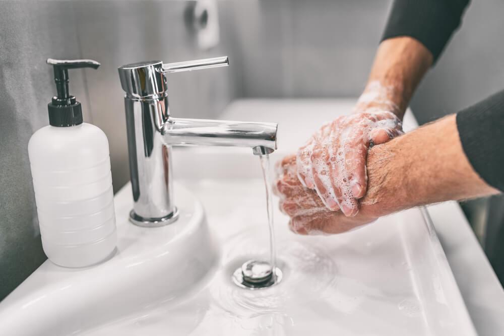 man washing hands to prevent coronavirus