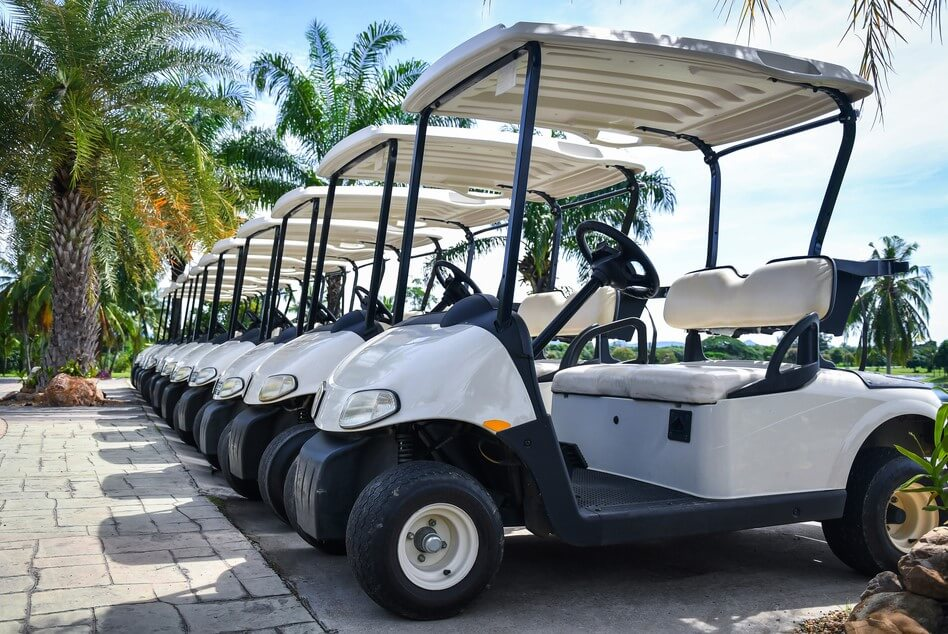 row of golf carts with insurance