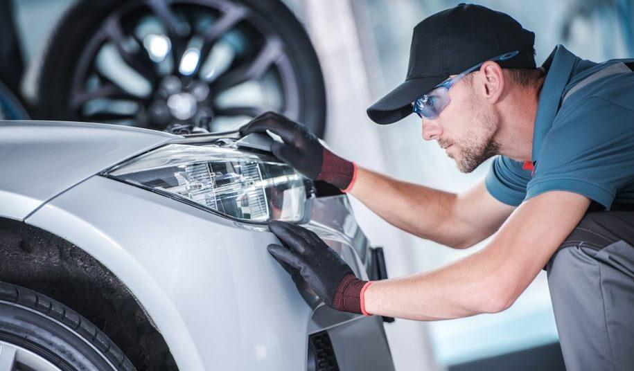 mechanic checking led headlights in car