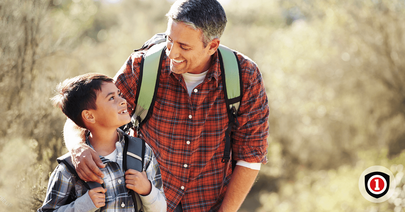 Father and son doing hiking while they have universal life insurance policy