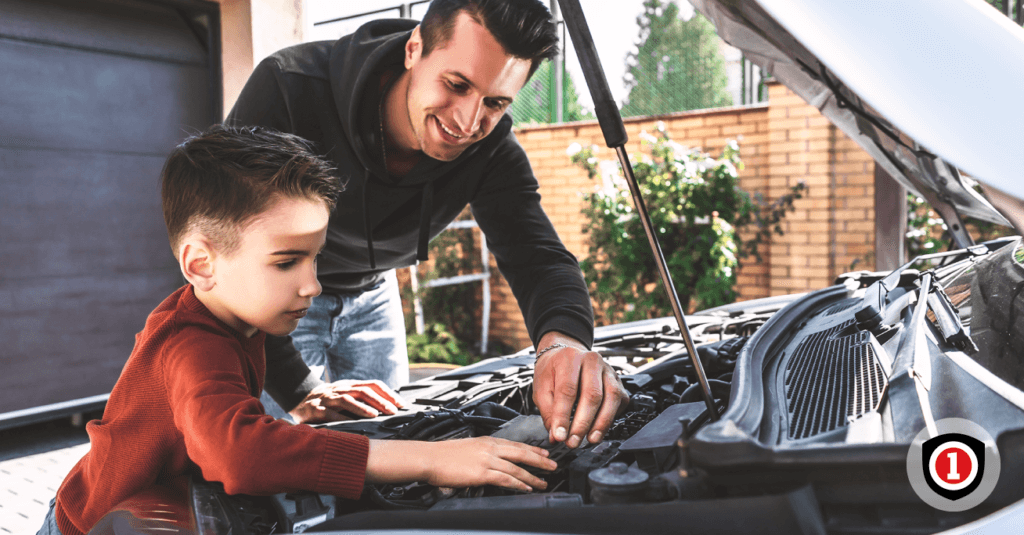 Father and son reviewing  the motor of their auto