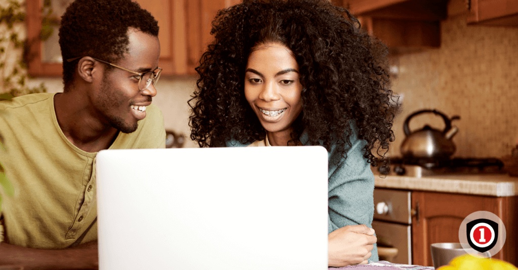 Couple searching life insurance options on a computer