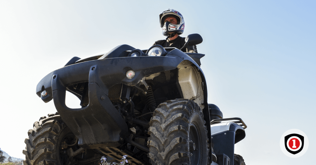 A man riding a quad bike while he has an ATV coverage
