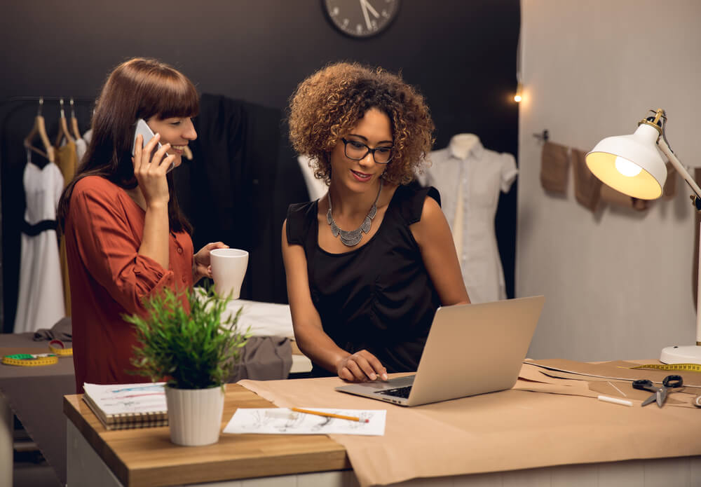 Two young entrepreneur women with employee benefits working