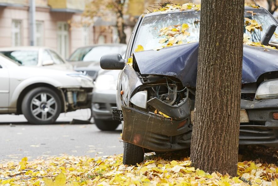 front view of car crashed into tree with full coverage insurance