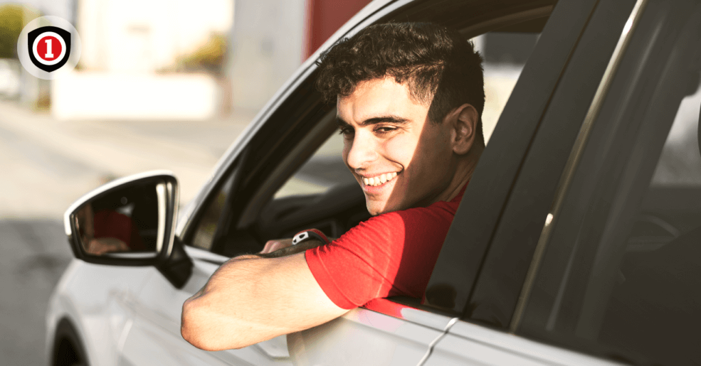 A Teen driver smiling while driving
