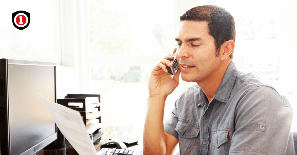 A man talking on the phone while reviewing an insurance policy