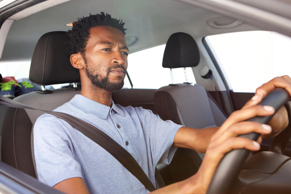 Close up portrait of african american man driving car