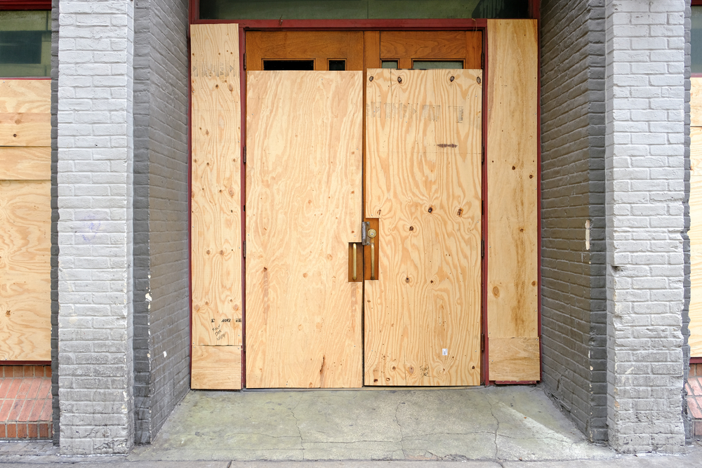 business location with boarded up front doors
